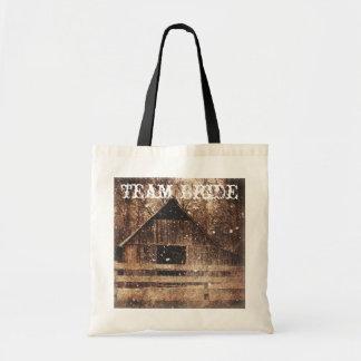 Beautiful  rustic country barn in the snowfall tote bags