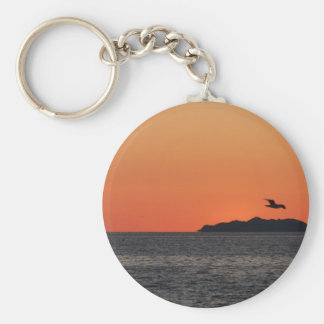 Beautiful sea sunset with island silhouette key ring