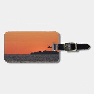 Beautiful sea sunset with island silhouette luggage tag