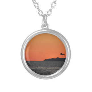 Beautiful sea sunset with island silhouette silver plated necklace