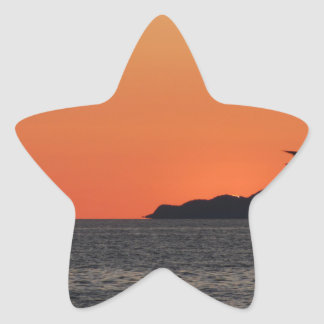 Beautiful sea sunset with island silhouette star sticker