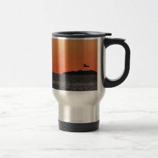 Beautiful sea sunset with island silhouette travel mug