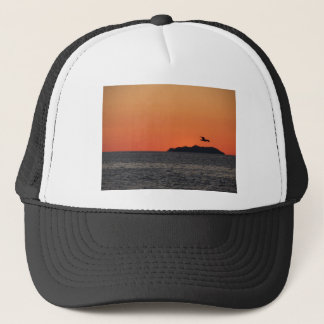 Beautiful sea sunset with island silhouette trucker hat
