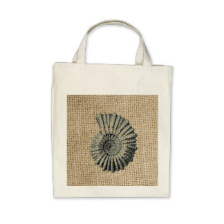 Beautiful seashell design on burlap background canvas bags
