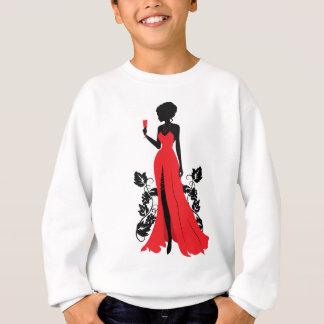 Beautiful silhouette of young woman with wineglass sweatshirt