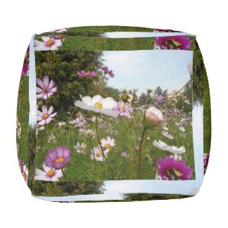 beautiful summer flowers around pouf