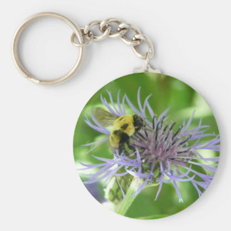 bee on a batchelor button key chains
