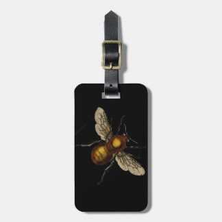 Bee on black luggage tag