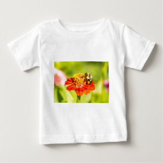 bee on red flower with pollen sacs baby T-Shirt