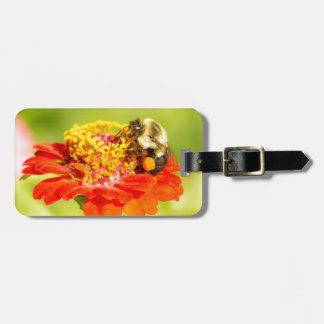 bee on red flower with pollen sacs luggage tag