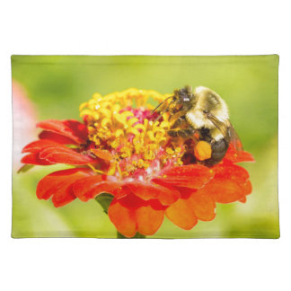 bee on red flower with pollen sacs placemat
