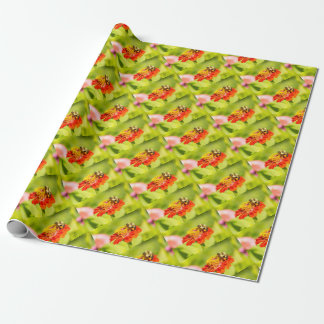 bee on red flower with pollen sacs wrapping paper