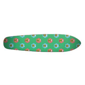 Bee pattern on green skateboard deck
