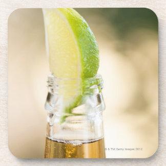 Beer bottle with lime wedge beverage coaster