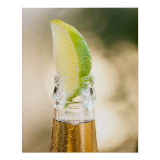 Beer bottle with lime wedge posters