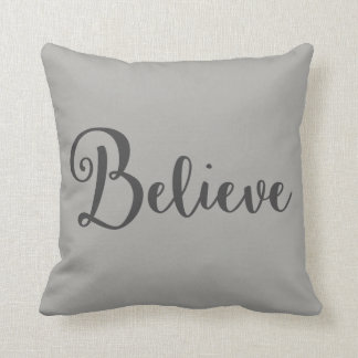 """Believe"" Text in Dark Grey on Grey Pillow"