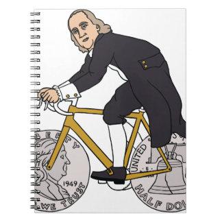 Ben Franklin On A Bike With Half Dollar Wheels Notebooks
