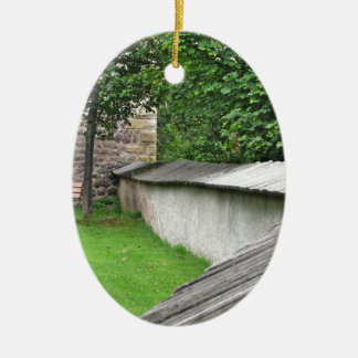 Bench in a meadow ceramic oval ornament