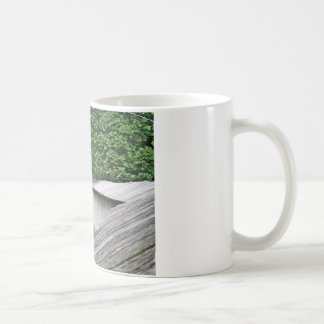 Bench in a meadow basic white mug