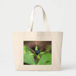 Berry of an herb paris (Paris quadrifolia) Large Tote Bag