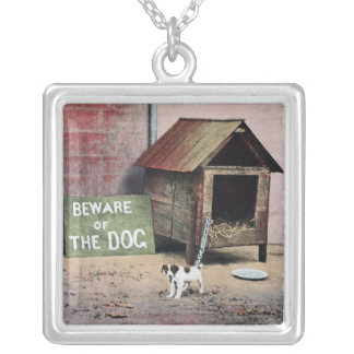 Beware of dog sign with small dog pendant