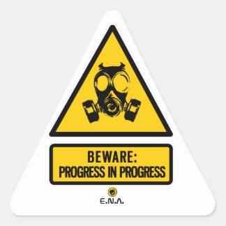Beware: progress in progress triangle sticker