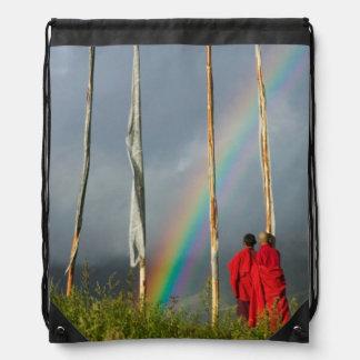 Bhutan, Gangtey village, Rainbow over two monks Backpacks