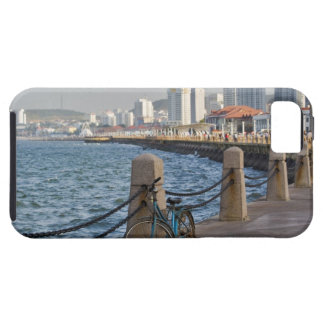 Bicycle at waterfront with Yantai city skyline, iPhone 5 Covers