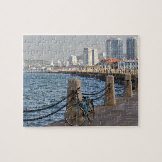Bicycle at waterfront with Yantai city skyline, Puzzle