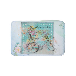 Bicycle with flower baskets on blue burlap bath mat