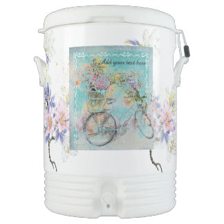 Bicycle with flower baskets on blue burlap drinks cooler