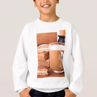 Big mug of hot cocoa with foam sweatshirt