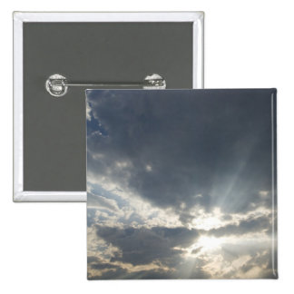 Big rays of light with many clouds and blue sky pinback button