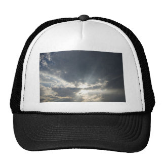 Big rays of light with many clouds and blue sky trucker hat
