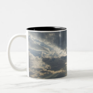 Big rays of light with many clouds and blue sky coffee mugs