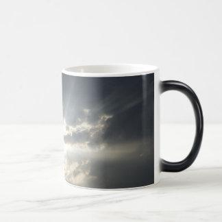 Big rays of light with many clouds and blue sky mug