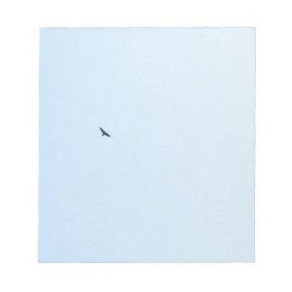 Bird Flying High in a Blue Sky Notepad