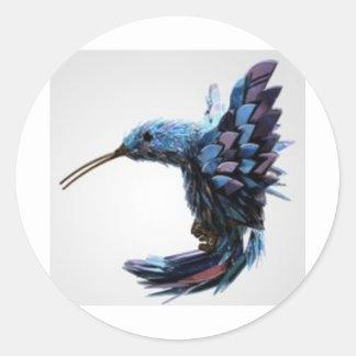 Bird hovering close round sticker