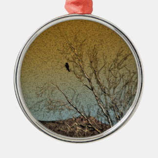 Bird in a tree round metal christmas ornament