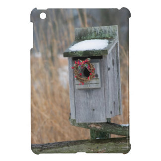 Bird, nest box with holiday wreath in winter case for the iPad mini