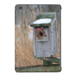 Bird, nest box with holiday wreath in winter iPad mini retina cover