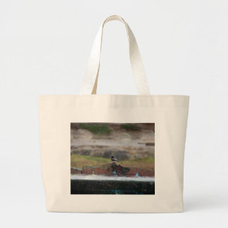 bird on a wall large tote bag