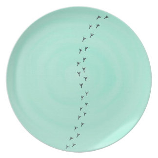 Bird tracks on pastel blue turquoise plate