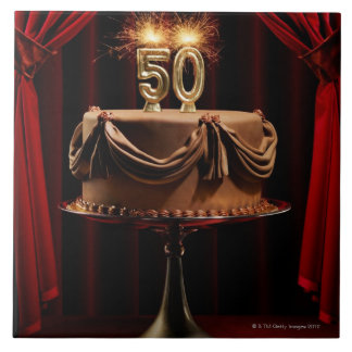 BIrthday Cake on Stage with number 50 candles Tiles
