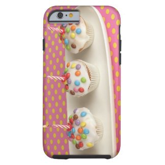 Birthday muffins with icing, sprinkles and iPhone 6 case