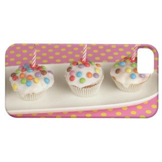 Birthday muffins with icing, sprinkles and iPhone 5 case