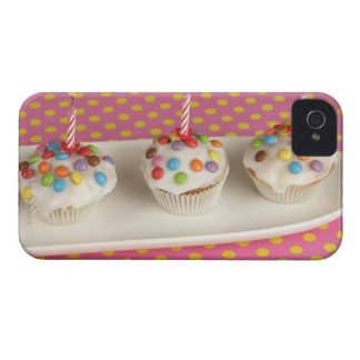 Birthday muffins with icing, sprinkles and iPhone 4 covers