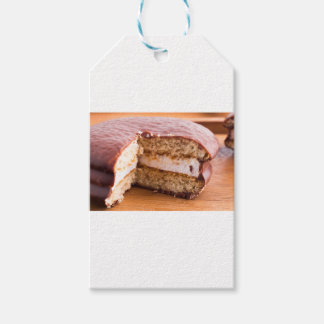 Biscuit with chocolate and a layer of milk souffle gift tags