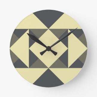 Black and gold triangles round clock