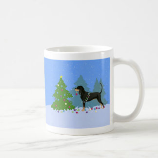 Black and Tan Coonhound Decorating Christmas Tree Coffee Mug